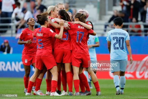 TOPSHOT United States' forward Alex Morgan celebrates with teammates after scoring a second goal during the France 2019 Women's World Cup Group F...