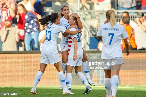 United States forward Alex Morgan celebrates with United States defender Emily Sonnett fans and teammates after scoring a goal in game action during...