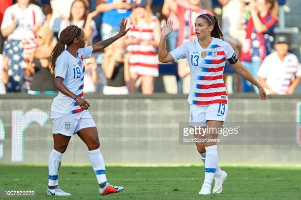 United States forward Alex Morgan celebrates with United States forward Crystal Dunn after scoring a goal in game action during a Tournament of...