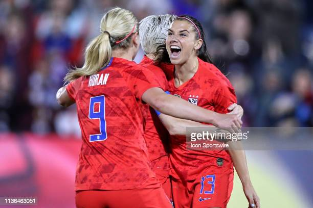 United states forward Alex Morgan celebrates with United states forward Lindsey Horan and United states forward Megan Rapinoe after scoring her 100th...