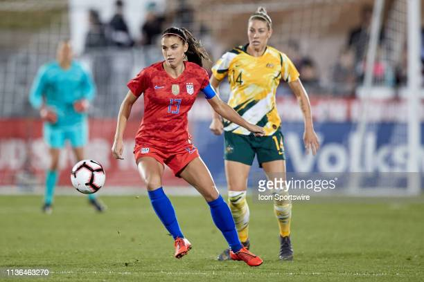 United states forward Alex Morgan dribbles the ball in game action during an International friendly match between the United states and Australia on...