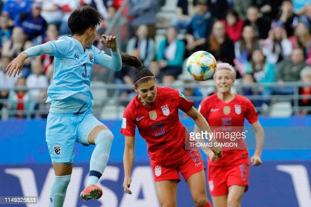 United States' forward Alex Morgan heads the ball and scores the opening goal during the France 2019 Women's World Cup Group F football match between...