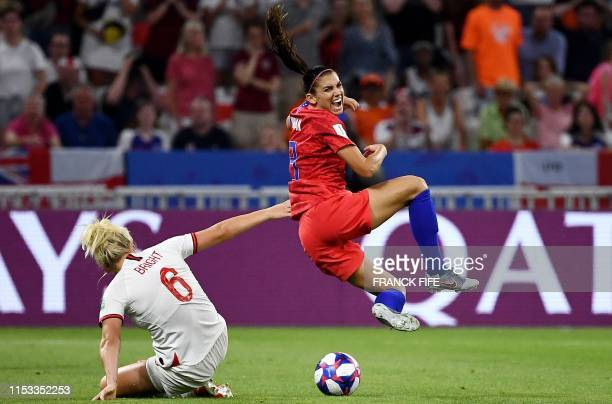United States' forward Alex Morgan is tackled by England defender Millie Bright during the France 2019 Women's World Cup semi-final football match...