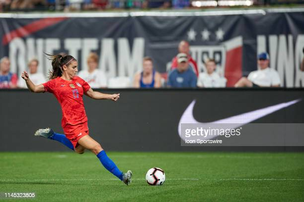 United States forward Alex Morgan kicks the ball in game action during an international friendly match between the United States woman's national...