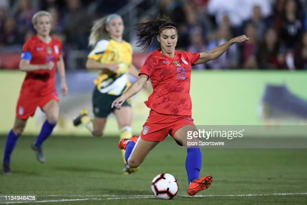 United states forward Alex Morgan shoots the ball for her 100th goal in game action during an International friendly match between the United states...