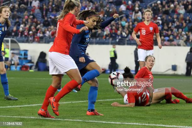 United States forward Alex Morgan takes a shot during the She Believes Cup match between the United States and England at Nissan Stadium on March 2nd...