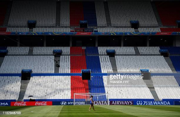 United States' forward Alex Morgan walks on the pitch during a training for the France 2019 Women's World Cup at the Groupama stadium in Lyon, on...