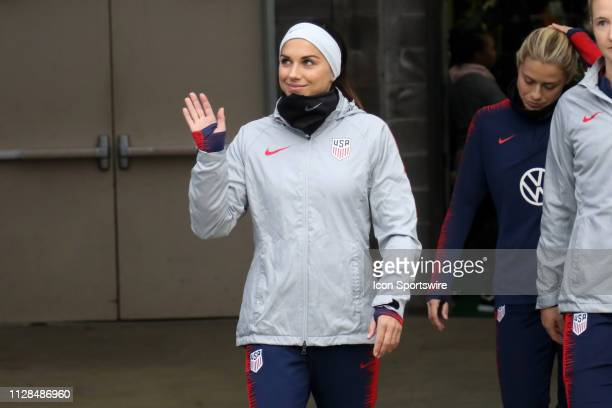 United States forward Alex Morgan waves to fans as she comes out of the tunnel before the She Believes Cup match between the United States and...