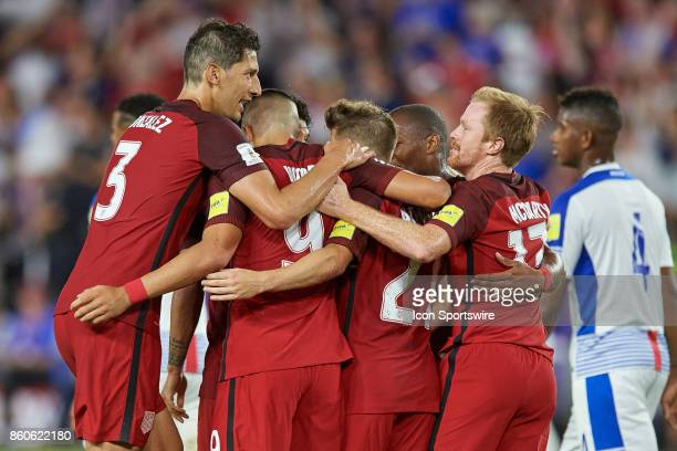 United States forward Bobby Wood celebrates with teammates after scoring a goal during the World Cup Qualifying match between the the United States...