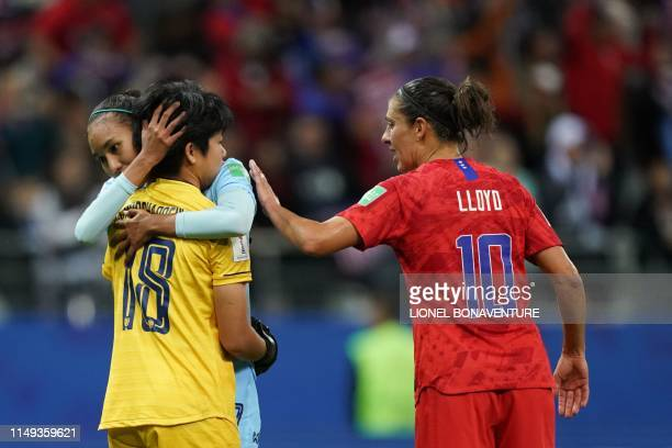 United States' forward Carli Lloyd and Thailand's goalkeeper Sukanya Chor Charoenying react after the France 2019 Women's World Cup Group F football...