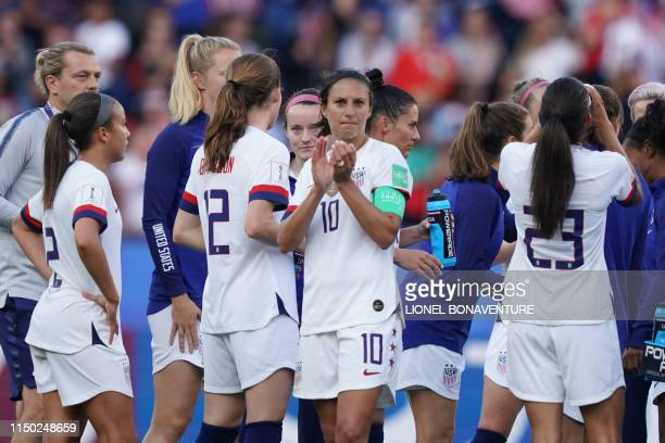 United States' forward Carli Lloyd applauds at the end of the France 2019 Women's World Cup Group F football match between USA and Chile on June 16...