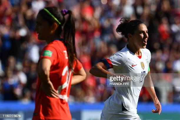 United States' forward Carli Lloyd celebrates after scoring a goal during the France 2019 Women's World Cup Group F football match between USA and...