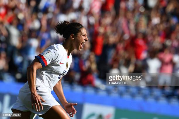 TOPSHOT United States' forward Carli Lloyd celebrates after scoring a goal during the France 2019 Women's World Cup Group F football match between...