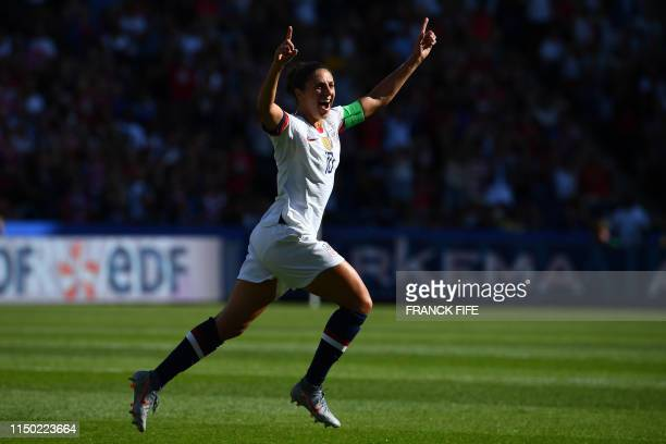 TOPSHOT United States' forward Carli Lloyd celebrates with teammates after scoring a goal during the France 2019 Women's World Cup Group F football...