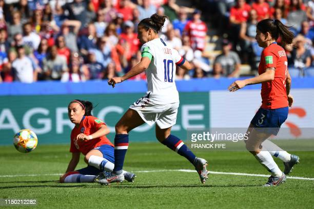 United States' forward Carli Lloyd kicks the ball in front of Chile's midfielder Karen Araya during the France 2019 Women's World Cup Group F...