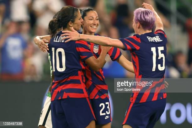 United States forward Christen Press celebrates with forward Carli Lloyd , forward Megan Rapinoe and teammates after scoring a goal in action during...