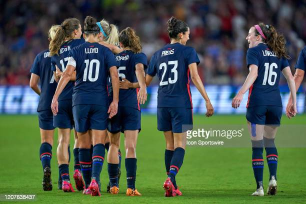 United States forward Christen Press celebrates with United States midfielder Rose Lavelle and teammates after scoring a goal during the Women's...