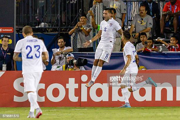 United States forward Clint Dempsey celebrates his second goal during the Group A CONCACAF Gold Cup stage match between the United States and...