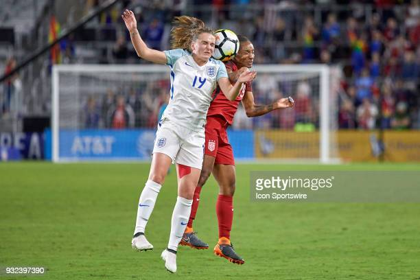 United States forward Crystal Dunn battles with England forward Mel Lawley to head the ball during the SheBelieves Cup match between USA and England...