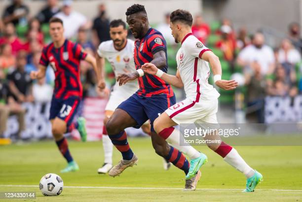 United States forward Daryl Dike makes an attacking run past the defense of Qatar defender Bassam Al Rawi during the Gold Cup semifinal match between...