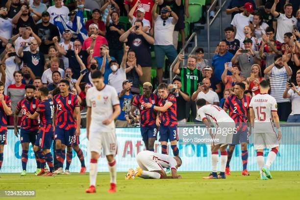 United States forward Gyasi Zardes and teammates celebrate in front of cheering fans during the Gold Cup semifinal match between the United States...