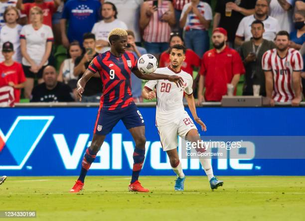 United States forward Gyasi Zardes brings down the ball in front of Qatar midfielder Abdullah Al Ahrak during the Gold Cup semifinal match between...