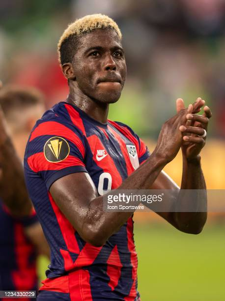 United States forward Gyasi Zardes claps toward the supporter section after defeating Qatar during the Gold Cup semifinal match between the United...