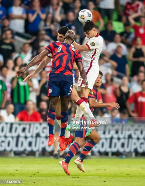 United States forward Gyasi Zardes heads the ball away from Qatar defender Bassam Al Rawi during the Gold Cup semifinal match between the United...