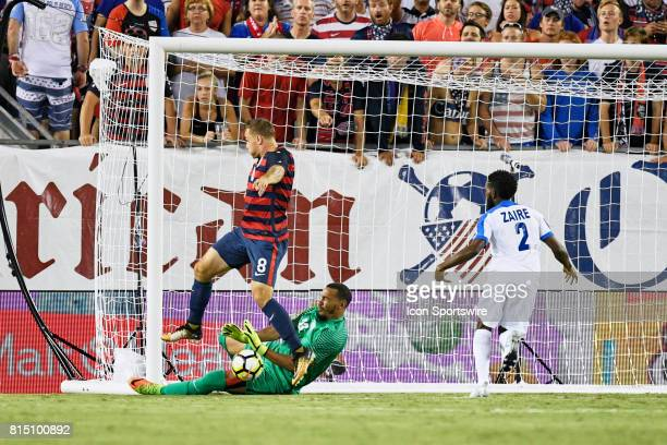 United States forward Jordan Morris attempts to score a goal past Martinique goalkeeper Kevin Olimpa during a CONCACAF Gold Cup Group B match between...