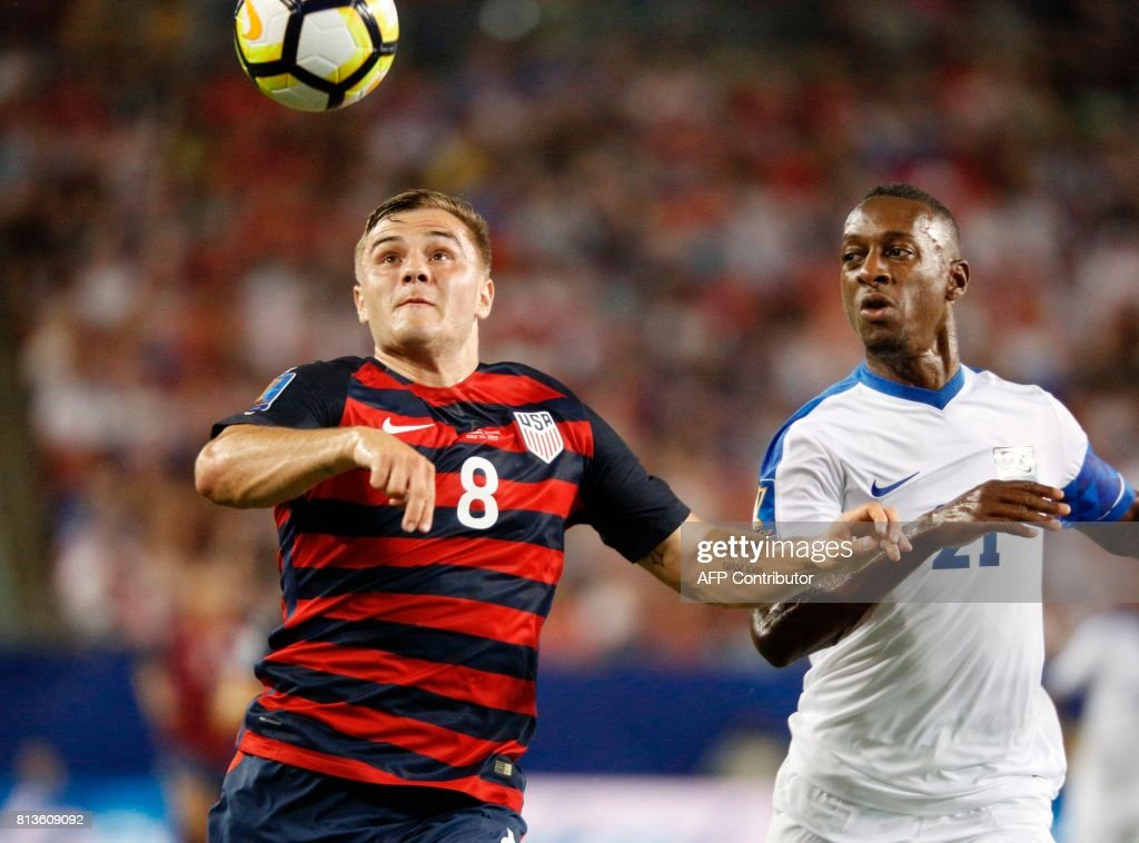 United States forward Jordan Morris (L) controls the ball ahead of Martinique defender Sebastien Cretinoir during their Group B Gold Cup soccer game on July 12, 2017 at Raymond James Stadium in Tampa, Florida. Morris scored two goals as the United States beat Martinique 3-2. / AFP PHOTO / Gregg Newton / Gregg Newton