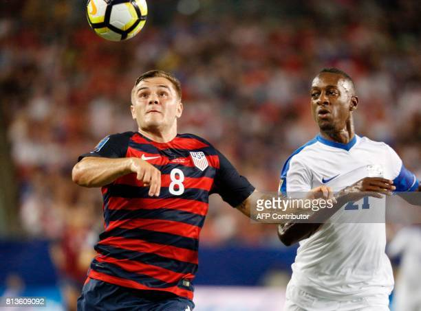 United States forward Jordan Morris controls the ball ahead of Martinique defender Sebastien Cretinoir during their Group B Gold Cup soccer game on...