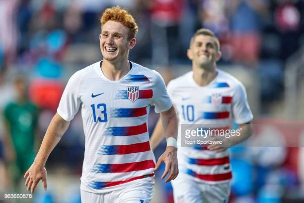 United States forward Josh Sargent celebrates his second half goal with United States midfielder Christian Pulisic and teammates during the...