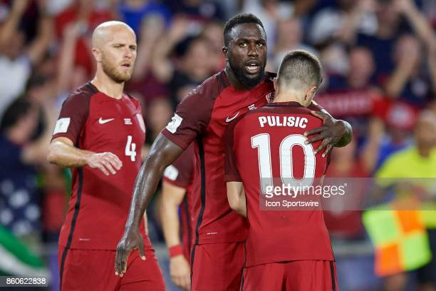 United States forward Jozy Altidore celebrates with United States midfielder Christian Pulisic and teammates after scoring a goal during the World...
