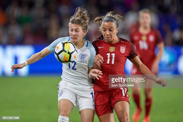 United States forward Mallory Pugh battles with England defender Hannah Blundell for a loose ball during the SheBelieves Cup match between USA and...