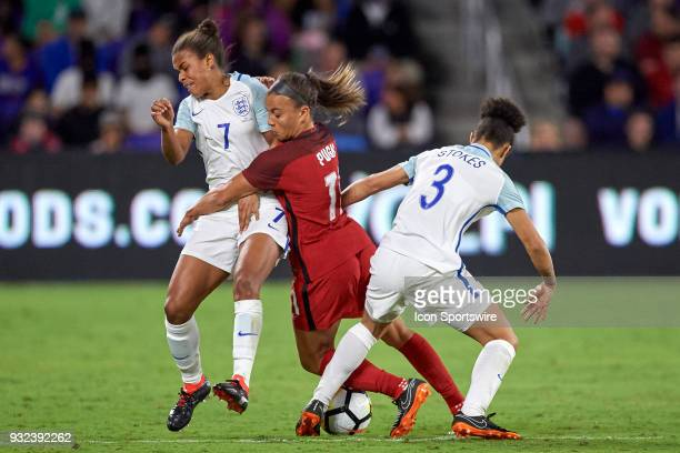 United States forward Mallory Pugh battles with England forward Nikita Parris and England defender Demi Stokes during the SheBelieves Cup match...