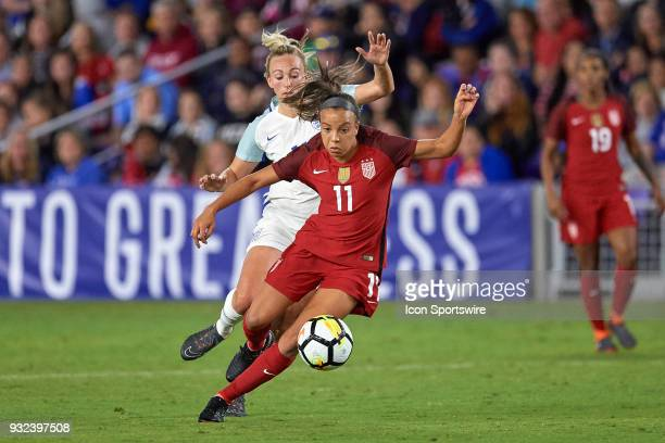 United States forward Mallory Pugh battles with England forward Toni Duggan for a loose ball during the SheBelieves Cup match between USA and England...