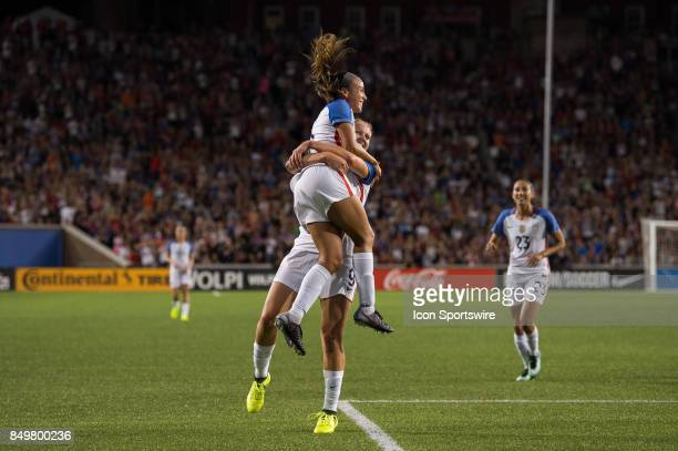 United States forward Mallory Pugh celebrates a score with United States midfielder Lindsey Horan during an International friendly match between the...
