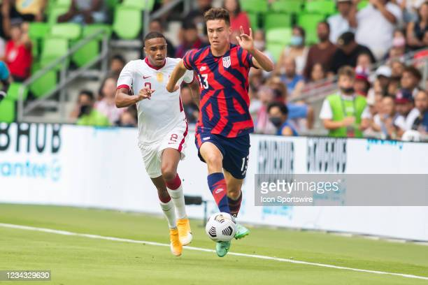 United States forward Matthew Hoppe attack the ball upfield ahead of Qatar defender Pedro Miguel during the Gold Cup semifinal match between the...