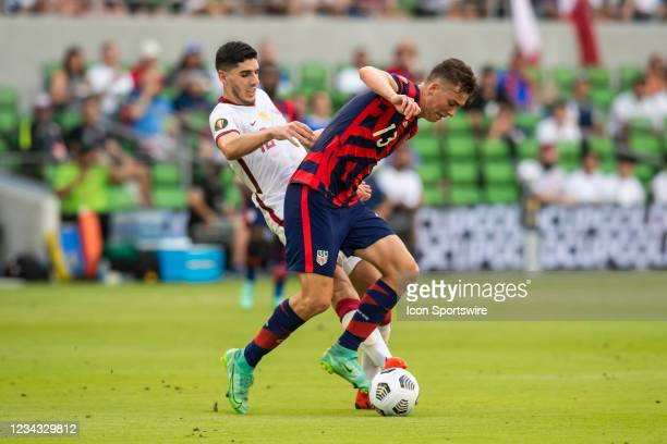 United States forward Matthew Hoppe attempts to maneuver past Qatar midfielder Karim Boudiaf during the Gold Cup semifinal match between the United...