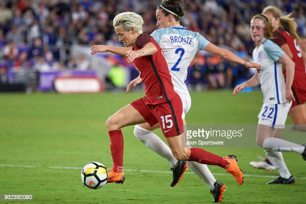 United States forward Megan Rapinoe battles with England defender Lucy Bronze and dribbles the ball during the SheBelieves Cup match between USA and...