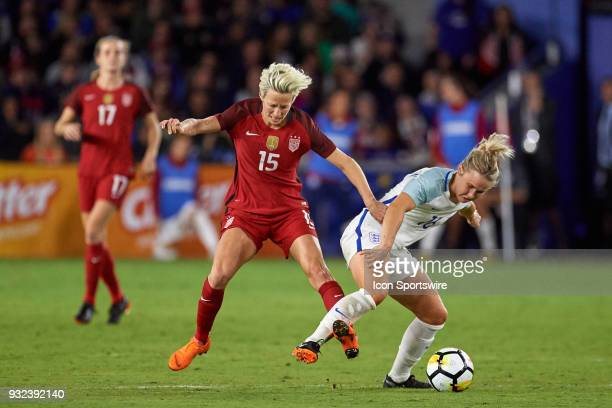 United States forward Megan Rapinoe battles with England midfielder Isobel Christiansen for the ball during the SheBelieves Cup match between USA and...