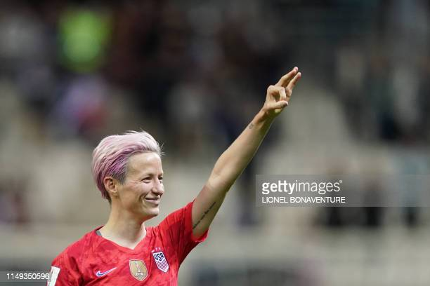 United States' forward Megan Rapinoe celebrate after winning the France 2019 Women's World Cup Group F football match between USA and Thailand on...
