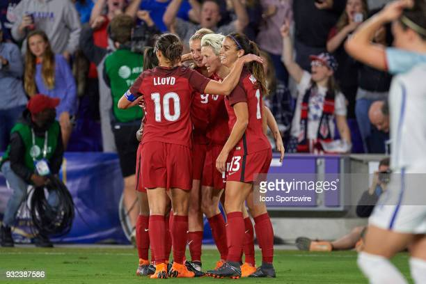 United States forward Megan Rapinoe celebrates with teammates after a own goal is scored by England defender Millie Bright during the SheBelieves Cup...