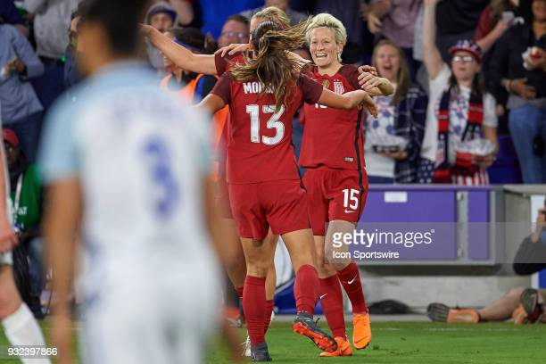 United States forward Megan Rapinoe celebrates with teammates after a own goal is scored by England defender Millie Bright during the match between...