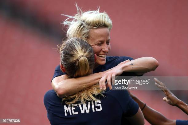 United States forward Megan Rapinoe celebrates with United States midfielder Samantha Mewis and teammates after scoring a goal in the first half of...