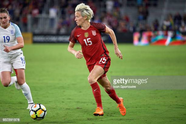 United States forward Megan Rapinoe dribbles the ball during the SheBelieves Cup match between USA and England on March 07 at Orlando City Stadium in...