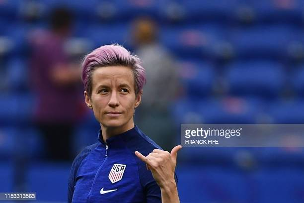TOPSHOT United States' forward Megan Rapinoe gestures as she walks around the pitch prior to the France 2019 Women's World Cup semifinal football...