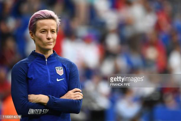 TOPSHOT United States' forward Megan Rapinoe looks on during warm up prior to the France 2019 Women's World Cup semifinal football match between...