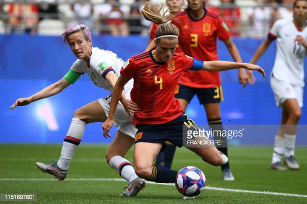 United States' forward Megan Rapinoe vies with Spain's defender Irene Paredes during the France 2019 Women's World Cup round of sixteen football...