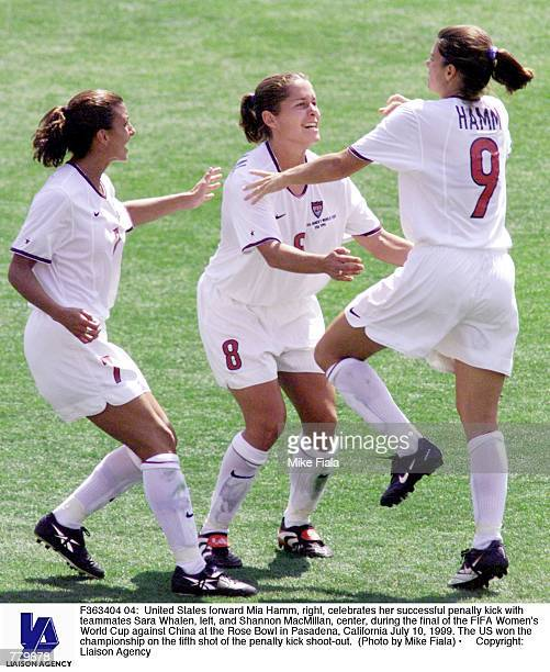United States forward Mia Hamm right celebrates her successful penalty kick with teammates Sara Whalen left and Shannon MacMillan center during the...